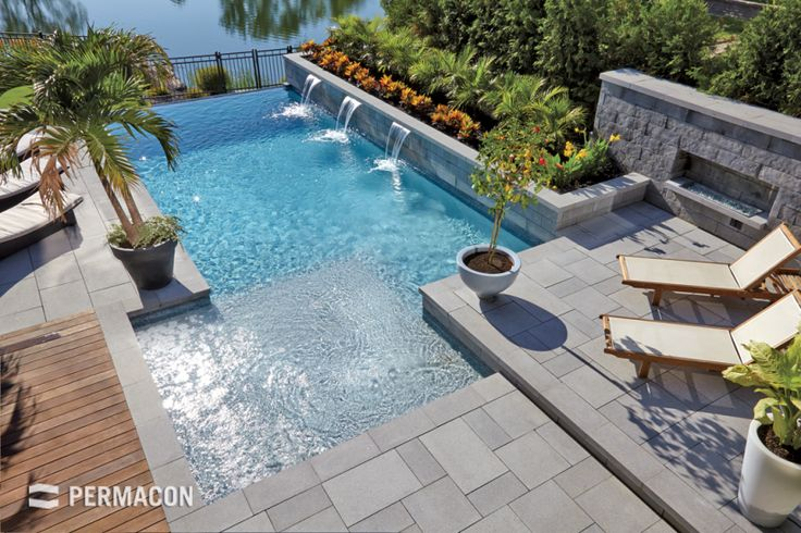 An elegant and tropical-inspired design for this poolside and flowerbed //// Un mélange d'élégance et d'éxotisme pour ce contour de piscine et plate-bande