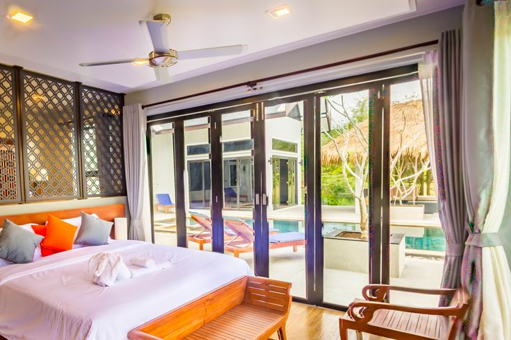 Shamballa Pool Villa on Koh Lanta Island, Krabi, Thailand. This 42sqm Master Suite #1 has direct access to the 10m swimming pool and 180degree Andaman sea views. Indonesian sandstone flooring, teak wardrobes, king sized bed and handmade bedside lamps furnish this exquisite bedroom suite.
