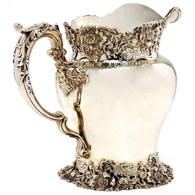 Antique Sterling Silver Pitcher with heavy applied decoration. By Dominick and Half, retailed by Bigelow Kennard Company. 37 troy ounces.