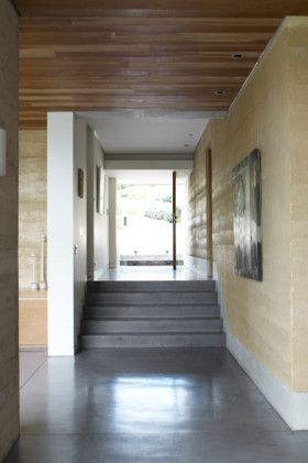 Rammed earth walls, polished concrete floor, and timber ceiling - just what we want.