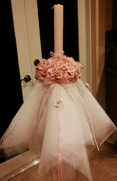 36 inch baptismal candle (Lambada) made for a princess.  Elegant tulle covered with flowers and pearls.  3 matching small candles made to match.