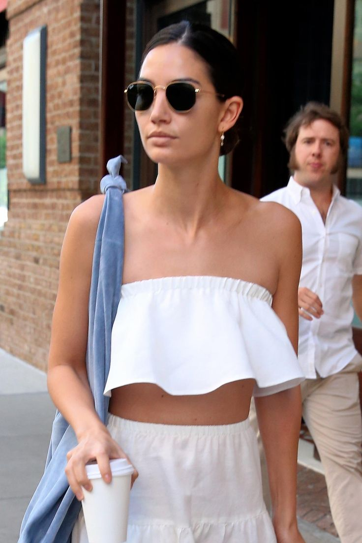 Lily Aldridge makes the case for a white crop top with a neat low bun.