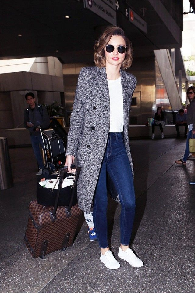 Miranda Kerr is spotted in her go-to outfit combo, a tee, jeans, sneakers, and a statement coat