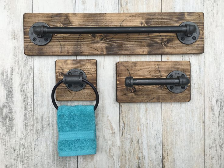 Industrial, rustic bathroom set of 3    DESCRIPTIONS: This industrial rustic bathroom set include bath towel holder, toilet paper holder and a hand towel ring. Industrial, rustic beautiful set of 3. It will make your bathroom outstanding and one of a kind. The wood is custom hand distressed. No two pieces are alike.   Its a great piece to any house. New and modern or old with character. Do you have a beach or vacation house? It will give you lots of complements when your guests arrive…