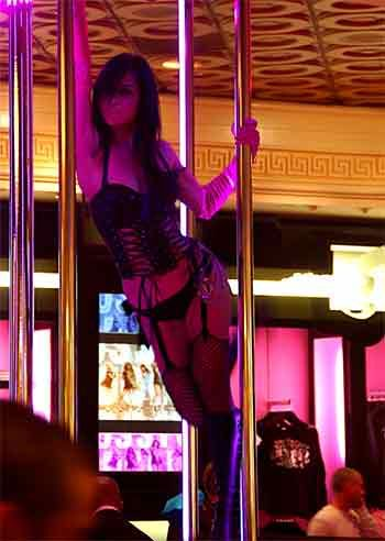 Slut Dancing Around The Pole At The Bar