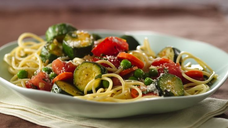 Garden Vegetable Spaghetti - A bounty from the garden--peas, carrots, onion, garlic, zucchini, tomatoes and basil--makes a delicious pasta topping.