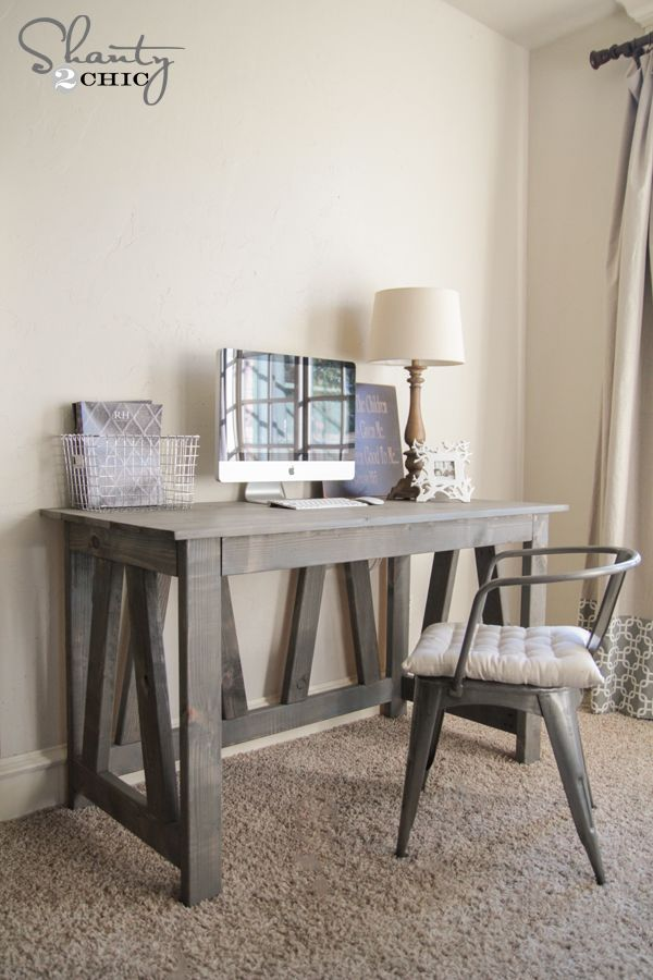 Ashley and Whitney from Shanty2Chic show you how to build this amazing rustic truss desk. Detailed, step-by-step plans included.