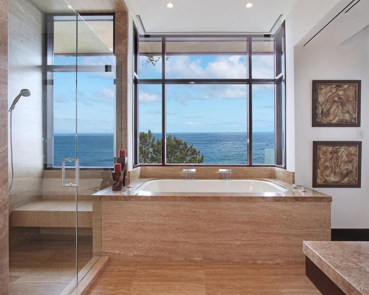 Contemporary Master Bathroom With Ocean View   Marble Sheathes The Floors  And Extends Onto The Tub