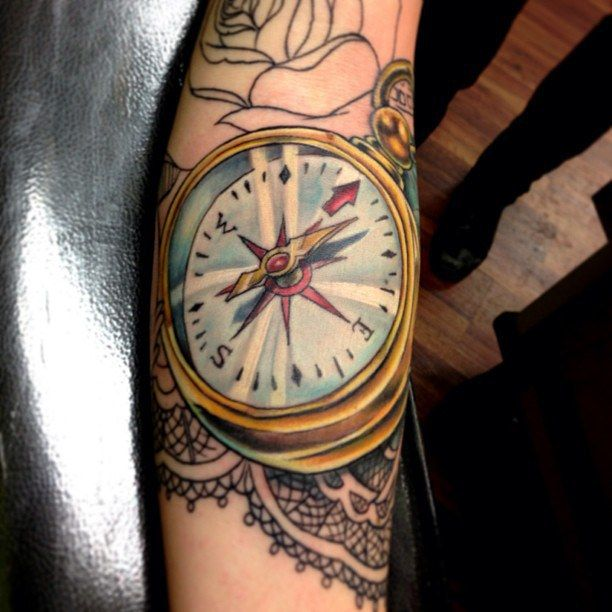 Great detail on this full color compass tattoo!