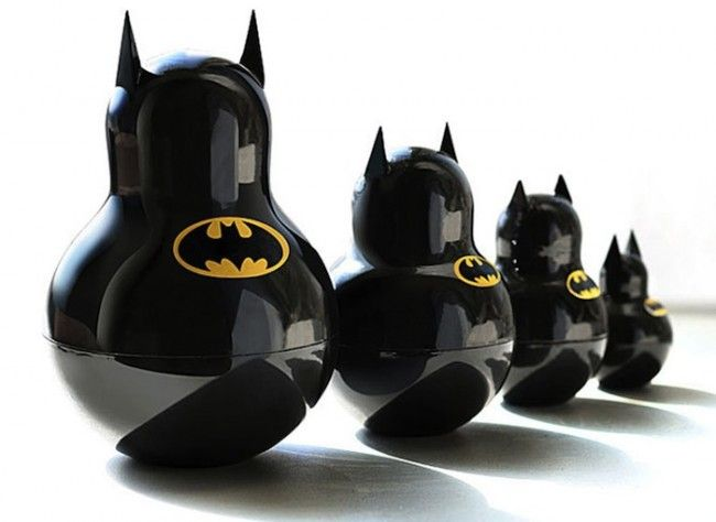 """While the traditional Russian Nesting doll calls for a women dressed in a rather bland outfit followed by subsequent women """"nested on the inside,"""" the work of art has seen a variety of variations. Case in point is this Batman inspired series from designer Katya Malakhova."""