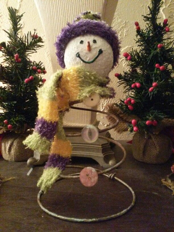 Recycled bed spring snowman. Head is wooden ball from Hobby Lobby,  hat and scarf are a sock,  and I mixed acrylic paint with glitter to get texture on head.