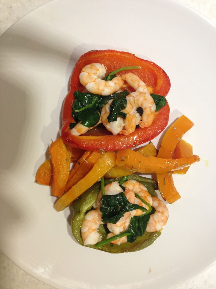 Baked peppers stuffed with prawns and spinach. Cooked in olive oil and ...