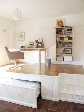 I love this little alcove! The desk space hides a bed underneath to increase storage- this would be such a perfect idea for a guest room or study area.