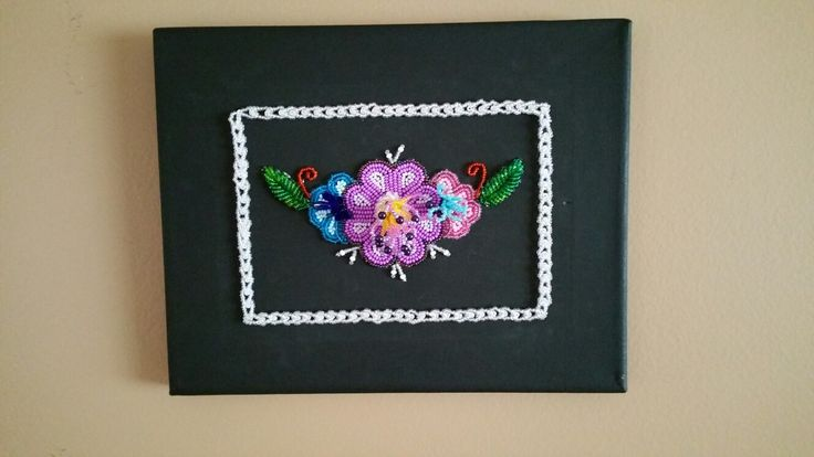Latest guady gloriousness! Beading directly onto a painters canvas means you can instantly hang it up when you are done....although this one could go up or down.  Made by dollface 2016 Iroquois Mohawk raised embossed beadwork