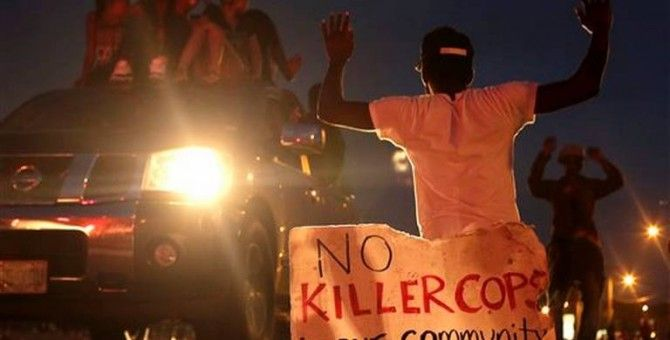 Police, protesters collide again over shooting of black teen