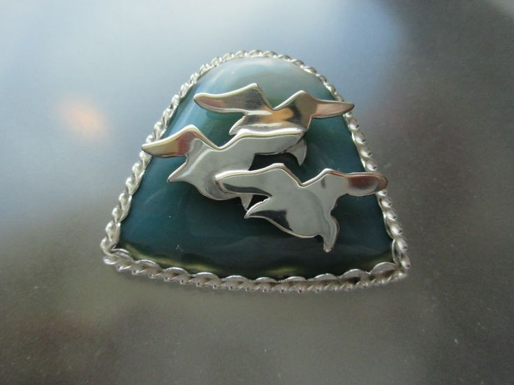 Silver Seagulls in Flight. Silver and agate pendant. Artist: Marie Wood