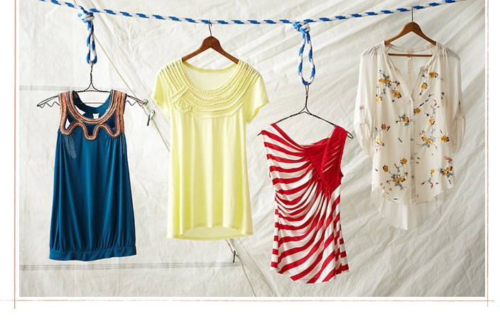 Loving the nautical inspirations! Also love how they hung the tops from simple rope