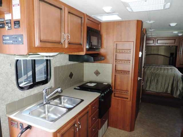 """2015 Used Fleetwood STORM 28MS Class A in California CA.Recreational Vehicle, rv, 2015 Fleetwood Storm 28MS THE PERFECT TAILGATING RV, Game Day 2 Captains Chairs,Rear View CameraDash, A/C,AM/FM/CD Stereo,Satelite Dish,Queen Drop Down Electric Bed, Jacknife Sofa, U Shaped Dinette,32"""" LCD TV 52"""" LCD TV w/ Sound Bar and WooferPower and Heated Mirrors. Pass-Thru Storage,, Pillow Top Mattress, This is Fleetwoods """" Game Day """" Coach.! Call Dean Chance at 562-623-1086 or email at Due to the nature…"""