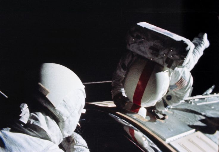 April 25, 1972 - Apollo 16 on it's trans-Earth coast and Charlie Duke watches and assists Ken Mattingly inspect the SIM Bay then retrieved film mapping and panoramic film cassettes from Casper's exterior.  (NASA photograph)