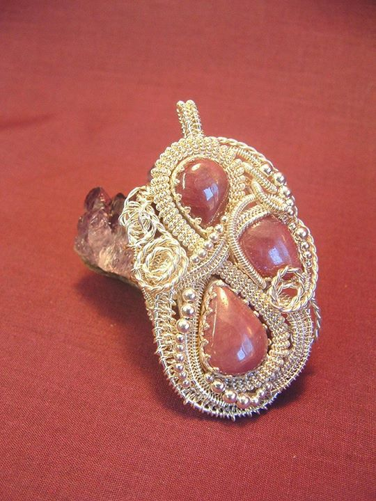 """""""Ruby Tears"""". All my own work, my own design. Three Burmese rubies, wrapped in sterling silver. Placed 1st at the Lower Clarence Arts and Crafts Association 48th Annual Exhibition in July 2013."""