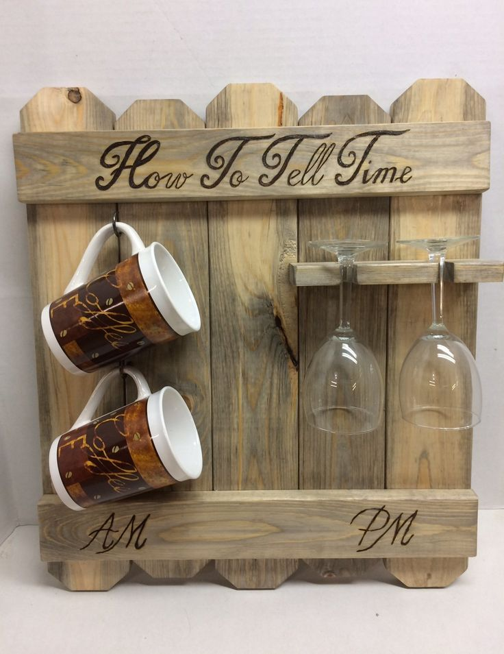 """Rustic blue pine How to tell time, AM PM sign, coffee mug and wine glass rack, wood burned coffee wine sign. This rustic How to tell time coffee wine sign is perfect for the real wine lover! This coffee mug, wine glass rack measures 20"""" x 17""""appx. It has the words """"How to tell time """" forever burned into the wood. It has been stained with minwax 3 in 1 stain, sealer, and protectant and the color is weathered oak . It has a coating of lacquer to help preserve the wood. Each rack will vary..."""