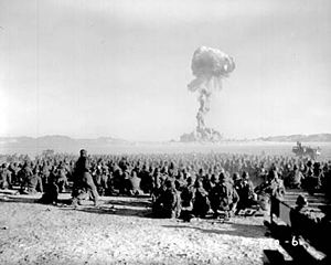 "November 1951 nuclear test at Nevada Test Site. Test is shot ""Dog"" from Operation Buster, with a yield of 21 kilotonnes of TNT (88 TJ). It was the first U.S. nuclear field exercise conducted on land; troops shown are 6 mi (9.7 km) from the blast."