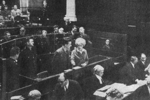 Photography is not permitted in British courts of law, but one anonymous journalist couldn't resist the opportunity to snap this infamous picture at the trial of the century. Standing in the dock are Ian Brady and Myra Hindley, better known as the Moors Murderers. The pair killed 5 children in a sadistic spree and buried their tiny bodies on the moorland. In court, they would whisper to each other, mocking the families' grief and they would pass notes on how they would murder their next…