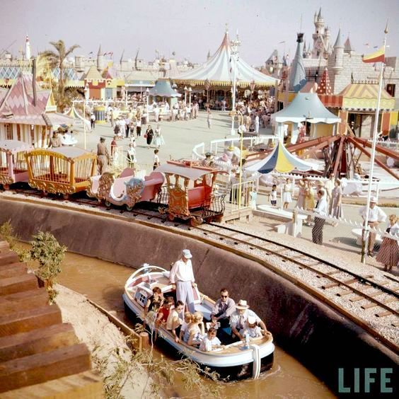 Life magazine must have done a huge spread on the opening day of Disneyland on July 17,1955 because there are quite a few wonderful photos by them. This one is a shot of the Storybook Land Canal Boats and Casey Jr. Railroad in Fantasyland. I've become so used to Disneyland's crowds that it's a constant source of amazement how few people there are in these photos. What bliss it must have been to wander the park without being jostled, nor having to wait in line for 3 hours for a 4-minute ride.