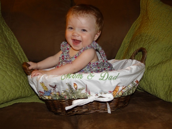 Okay, not the best shot ever but um my baby fits in our easter basket =) I <3 her.
