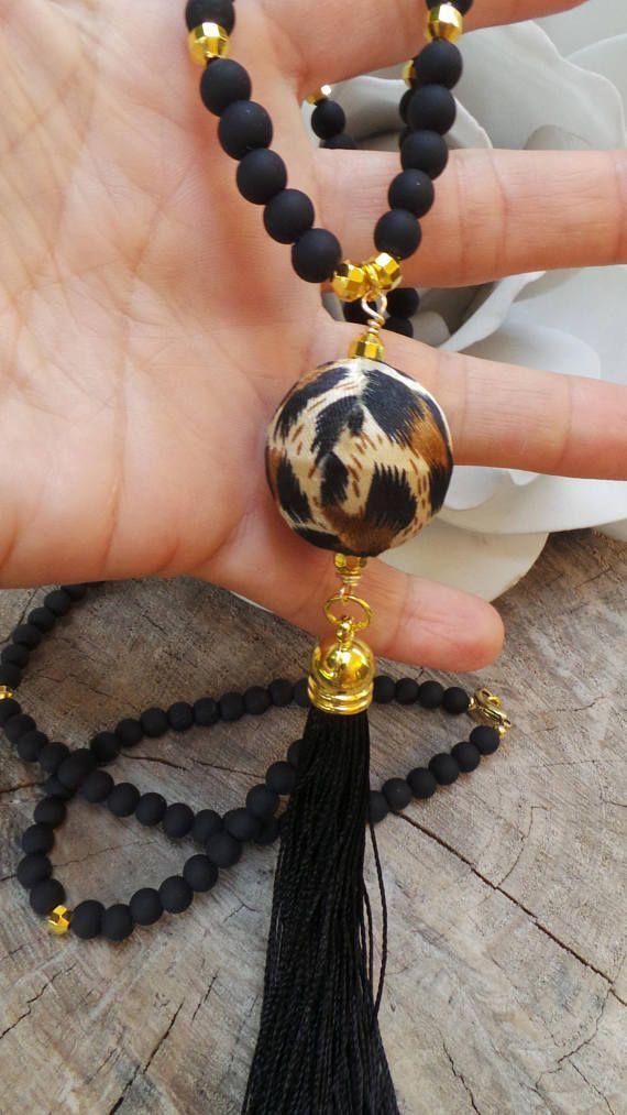 Long beaded black tassel necklace. Animal print necklace.