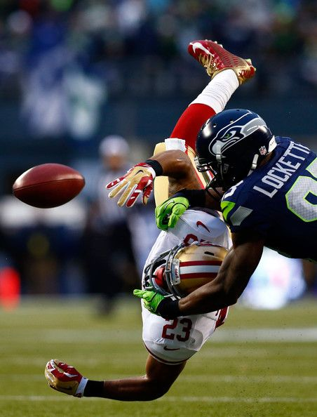 Kick returner LaMichael James #23 of the San Francisco 49ers is hit by wide receiver Ricardo Lockette #83 of the Seattle Seahawks during the 2014 NFC Championship game