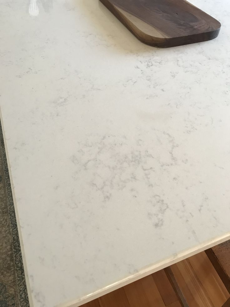 Quartz countertops in Calacatta Vicenza with eased edge