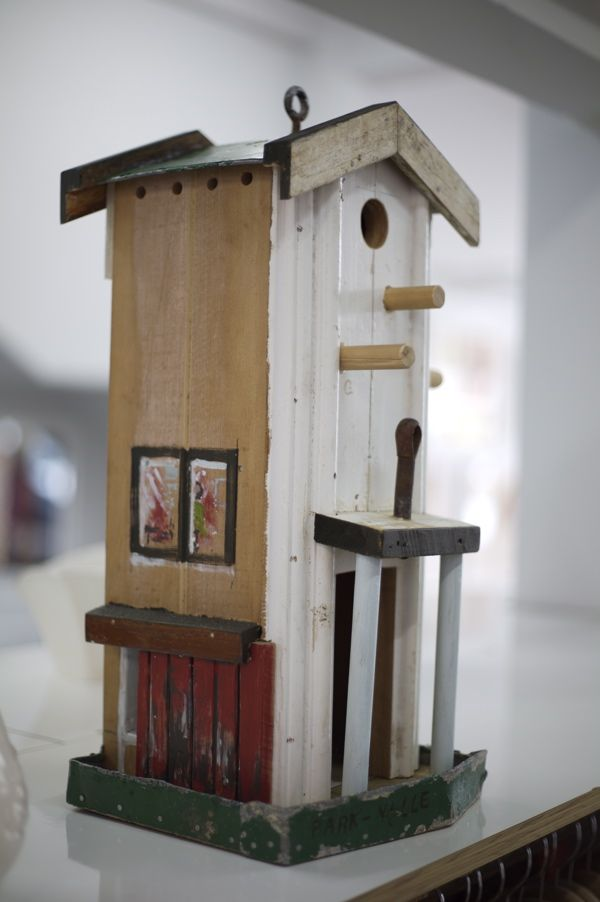 Perry Davies is a New Zealand  artist who crafts  bird houses  from found and recycled materials.