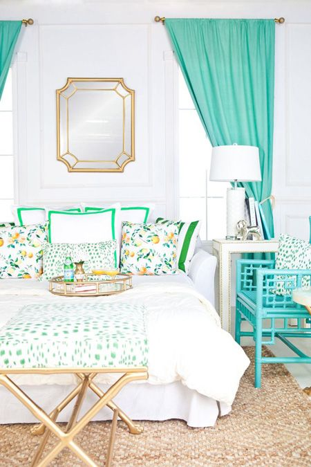 Green and turquoise look ultra fresh in this sophisticated bedroom. The gold accents bring a glamorous touch that elevates the style