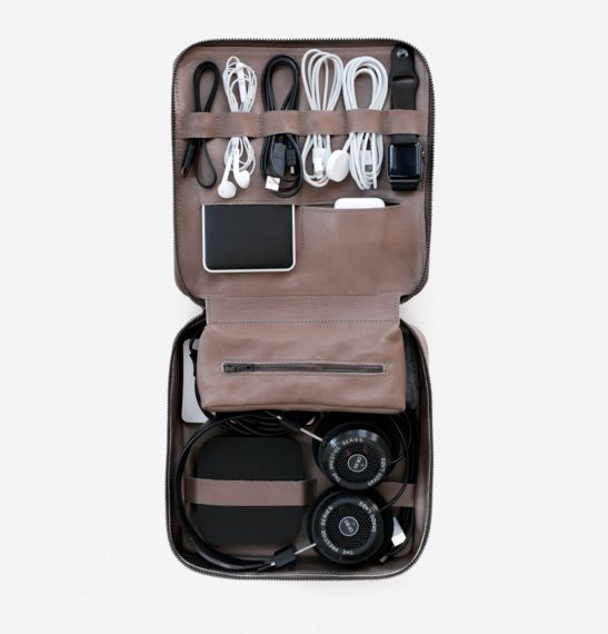 A zip-up organizer with a designated home for each of your tech accessories. With room on both sides to strap down your cords, adapters, headphones, and other necessities, the Tech Dopp Kit uses space