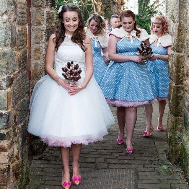 "Bride Hannah and her maids teamed pink petticoats with their Kitty & Dulcie gowns. ""We loved our dresses so much and got so many compliments! I wish I could wear my Pearly Queen wedding dress every day."" #KittyAndDulcie #pearlyqueenweddingdress #DorothyDreamBridesmaidDress #bridetobe #bridesmaiddress #bridesmaids #vintagebride #vintageinspired #retrowedding #retro #weddinginspiration #weddinghair #weddingplaner #love #engagement #spottydress #summerdress #kittyanddulciebride"