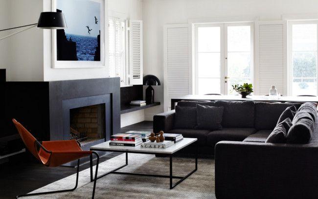 Custom sofa, rug and coffee table by Robson Rak, 'Paulistano' armchair by Objekto, 'Spar' floor lamp by Resident