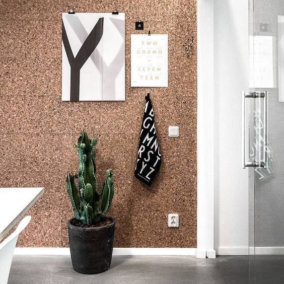 cork wall as mood board styled with cactus and posters interior trends