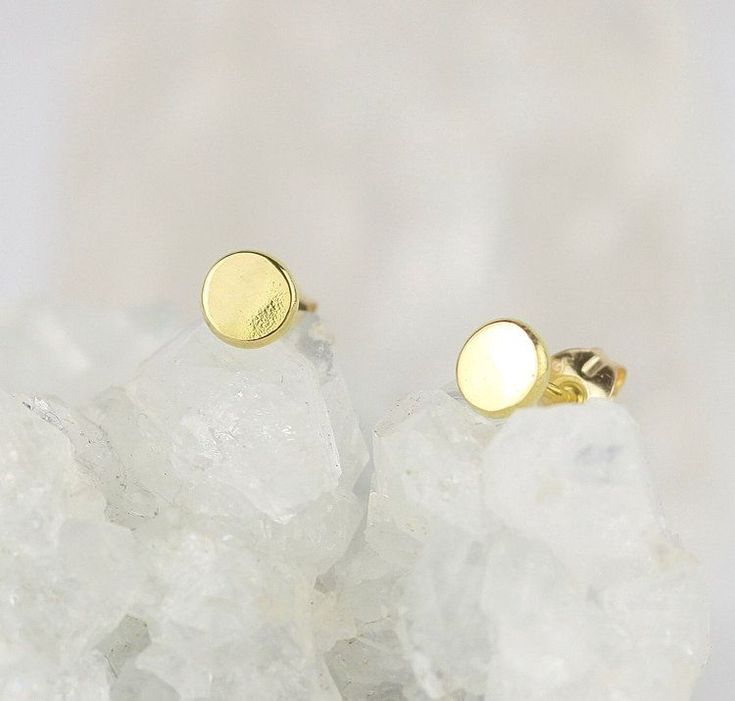 Dainty little 18ct gold stud earrings. Petite real gold studs. Make perfect wedding jewellery. Minimalist delicate earrings. A percentage of every sale is donated to the refugee charity CalAid. Buy gifts that give back. #RealGoldJewellery