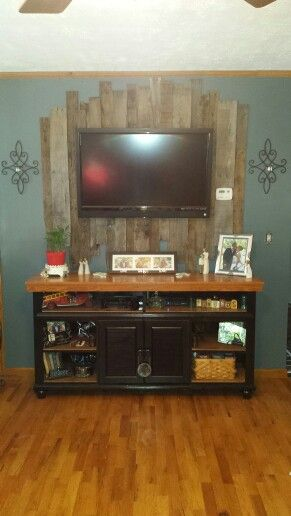 Pallet Boards behind TV and Old Dresser Repurposed into a New Entertainment Center!!! Loving it!!!