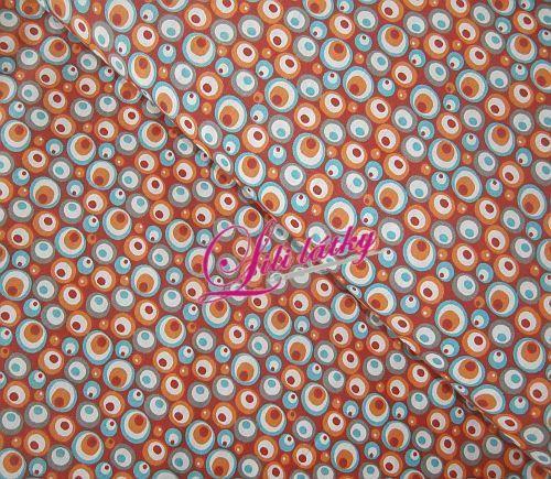 Bavlněná látka  Bublinky barevné na oranžové