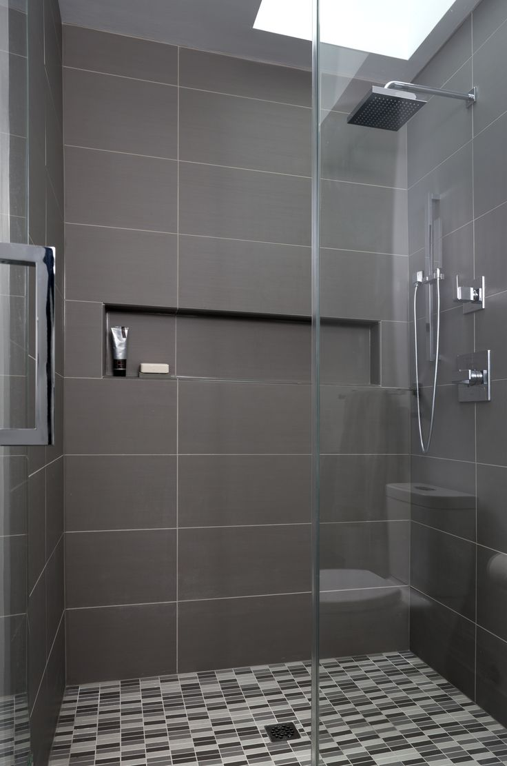 Warm gray porcelain tiles create a modern masculine feel in this recent  Woodley Park-DC  Tile Walk In ShowerLarge ...
