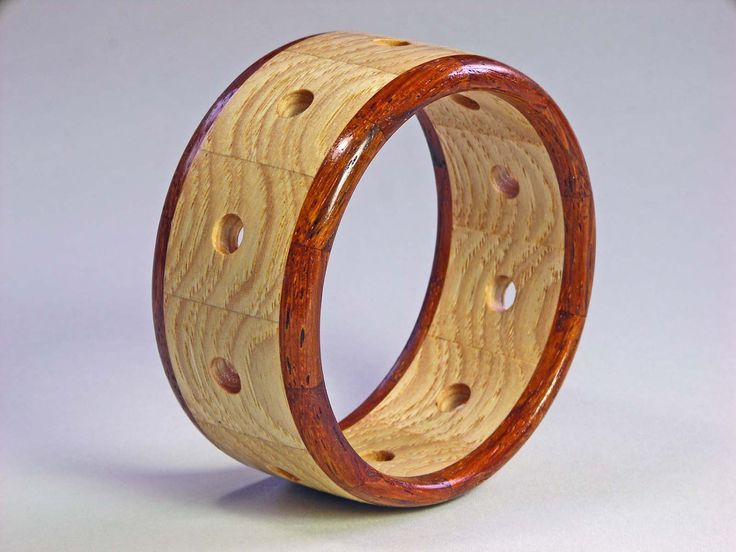 segmented and turned [The drilled holes are simple yet add value to the turning]