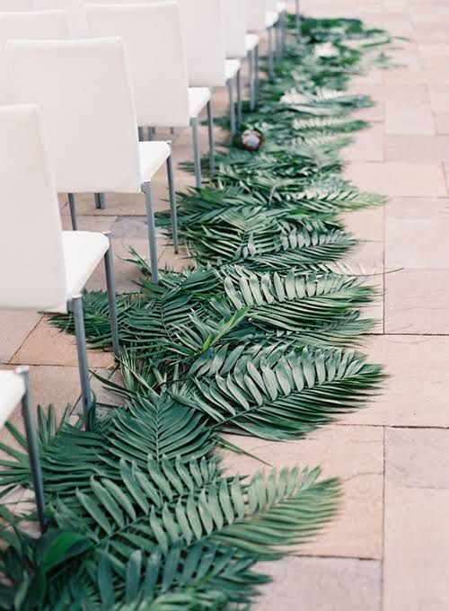 Palm Leaves: Lush, deep-green palm fronds (or other tropical greenery) look so chic when they're fanned out along the aisle.