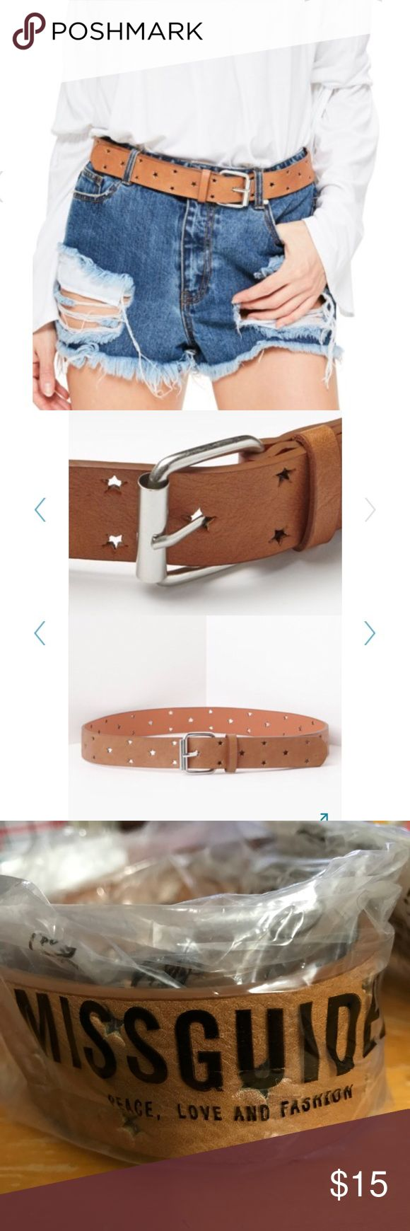 """Missguided Cutout Star Faux Leather Belt OS New with tags!  Missguided Cutout Star Faux Leather Belt.  Tan with silver hardware.  Make any look more stellar with this faux leather belt perforated with laser-cut stars.  Can fit up to about a size 8/10- see length.  Holes for buckle go around entire belt (stars).  - 1 1/4"""" width; 1 3/4"""" x 1 /2"""" buckle.   38"""", prong to tip.  Sold out online! Missguided Accessories Belts"""