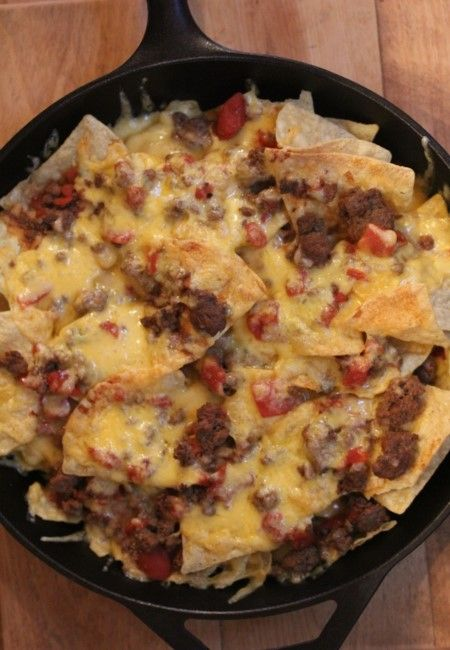 Chili cheese nachos are a simple quick and easy dinner. They are also a great way to use up leftover chili or freezer chili. They are a great game day snack