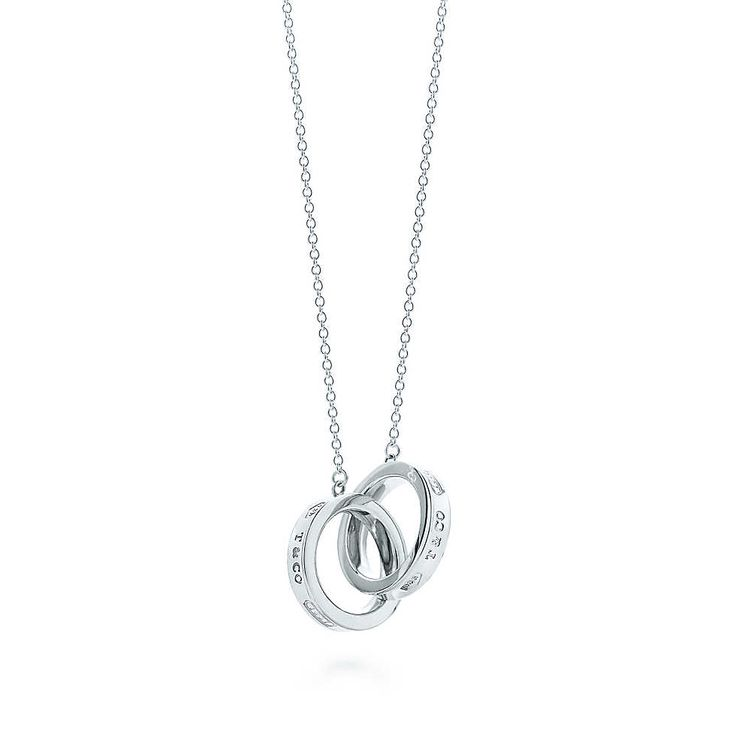 "GOT IT! :) I've always liked this necklace. Kind of wedding-y, romantic. Interlocking Circles Pendant. A timeless favorite, inscribed with the year Tiffany was founded. Pendant in sterling silver. Size small, on a 16"" chain. $225"