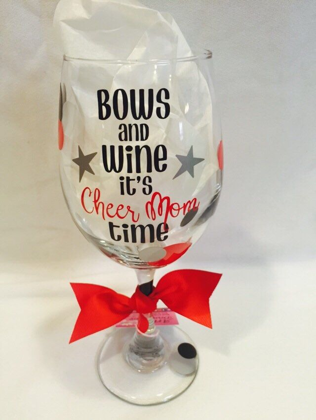A personal favorite from my Etsy shop https://www.etsy.com/listing/286044425/cheer-mom-wine-glass-bows-and-wine-its