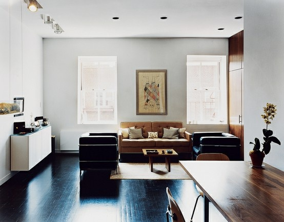 neutral living room with black floors