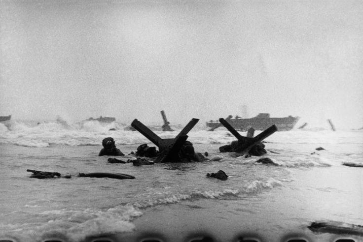Robert Capa, US troops assault Omaha Beach during the D-Day landings, Normandy, June 6th 1944.
